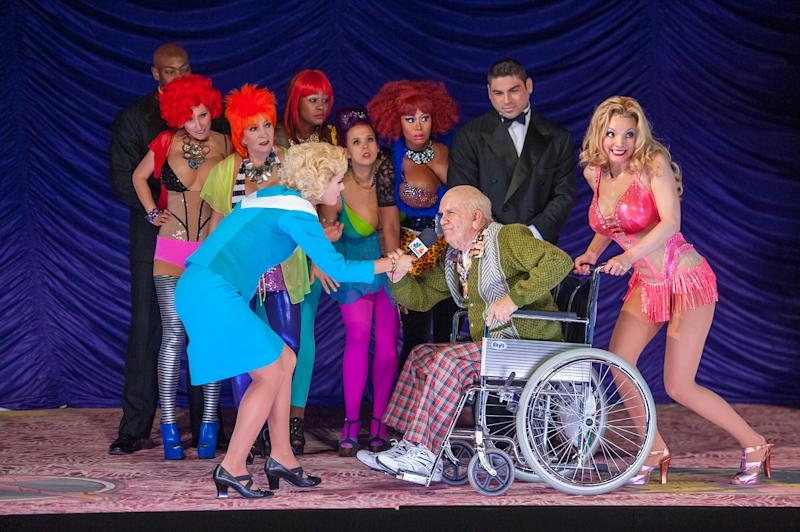 "This Sept. 15, 2013 image released by the Booklyn Academy of Music shows, foreground from left, Sarah Coomes, Robert Brubaker and Sarah Joy Miller in a Scene from ""Anna Nicole"" composed by Mark-Anthony Turnage at the Brooklyn Academy of Music Opera House in the brooklyn borough of New York. New York City Opera says it likely will fail in its goal to raise $7 million by Monday, the deadline it set for suspending the bulk of its 2013-14 season. (AP Photo/BAM, Stephanie Berger)"