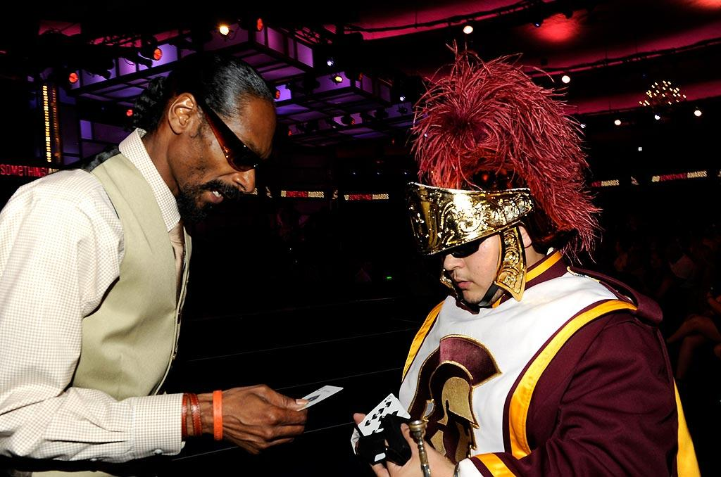 """Snoop Dogg chilled with a member of the USC marching band. He had the entire group play """"Who Am I (What's My Name)?"""" as he accepted the Do Something for the Kids prize. Kevin Mazur/<a href=""""http://www.wireimage.com"""" target=""""new"""">WireImage.com</a> - July 19, 2010"""