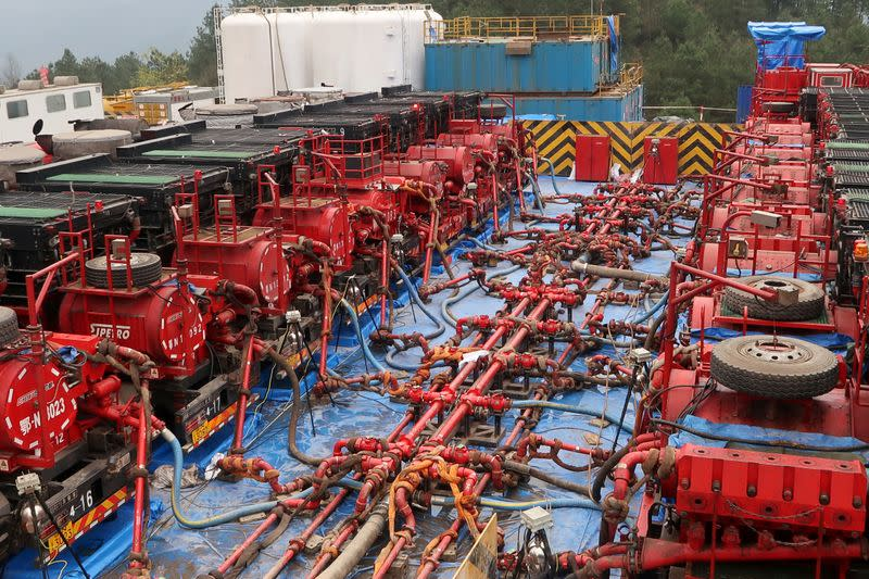 FILE PHOTO: Fracking trucks at work are seen at a shale gas well of Sinopec in Nanchuan, Chongqing