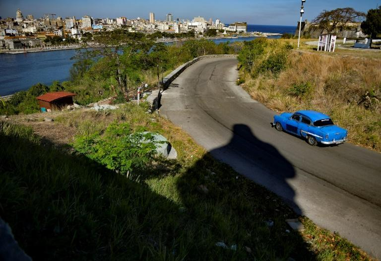 An old American car drives along a street of Havana, on April 16, 2021 as some 300 delegates from across the island nation gathered in the city to discuss topics such as the economy and mobile internet