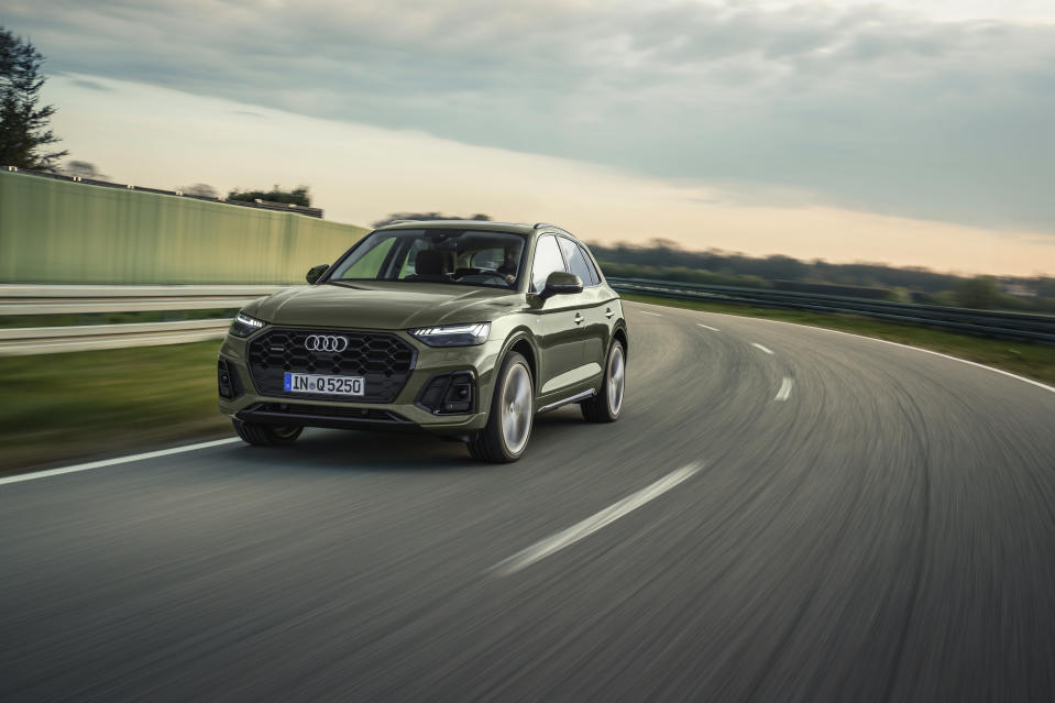 This photo provided by Audi AG shows the 2021 Audi Q5, sporting a new look that the automaker hopes will draw in people looking for a little more excitement from their luxury crossover. (Tobias Sagmeister/Courtesy of Audi AG via AP)