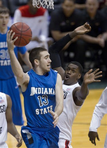 Indiana State guard Jake Odum (13) looks to pass off the basketball while being defended by San Diego State forward Deshawn Stephens (23) in the first half of an NCAA college basketball game in the Diamond Head Classic on Sunday, Dec. 23, 2012, in Honolulu. (AP Photo/Eugene Tanner)