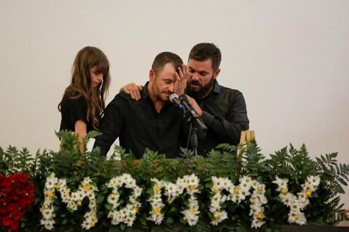 Tyler Johnson, husband of Christina Marie Langford Johnson, who was killed by unknown assailants, reacts during her funeral service, before a burial at the cemetery in LeBaron, Chihuahua