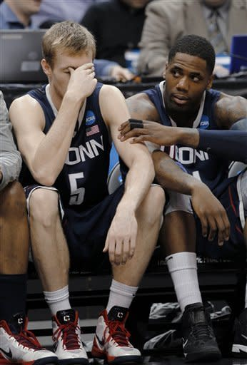 Connecticut's Niels Giffey (5) is consoled by teammate P.J. Cochrane in the second half of an NCAA men's college basketball tournament second-round game against Iowa State in Louisville, Ky., Thursday, March 15, 2012. iowa State beat Connecticut 77-64. (AP Photo/John Bazemore)