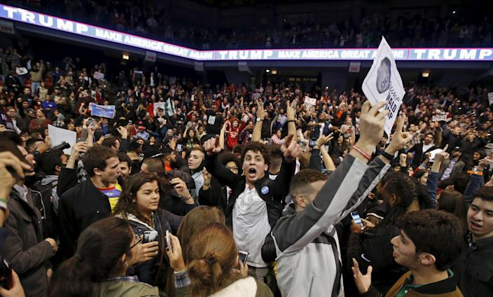 Demonstrators celebrate after Republican U.S. presidential candidate Donald Trump cancelled his rally at the University of Illinois in Chicago March 11, 2016. (REUTERS/Kamil Krzaczynski)