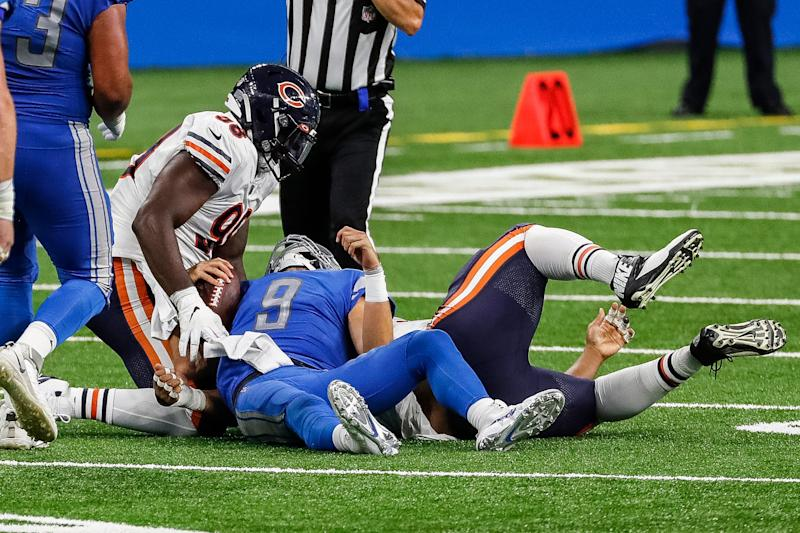 Detroit Lions quarterback Matthew Stafford is tackled by Chicago Bears defensive tackle Akiem Hicks (96) during the second half at Ford Field, Sunday, Sept. 13, 2020.
