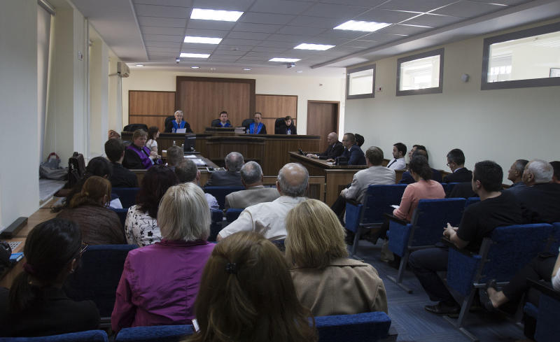 A panel of Judges prepare to deliver a verdict in a trial against 7 Kosovars suspected of running a organ trafficking criminal ringA Kosovo court has found two ethnic Albanians guilty of human trafficking and organized crime in a highly publicized trial against seven people suspected of running an international organ trafficking ring. A panel of two European Union and one Kosovo judges sentenced Lutfi Dervishi to eight years in prison and his son Arban Dervishi to seven years and three months in prison on Monday for extracting kidneys from poor donors who were lured by financial promises. ( AP Photo/Visar Kryeziu)