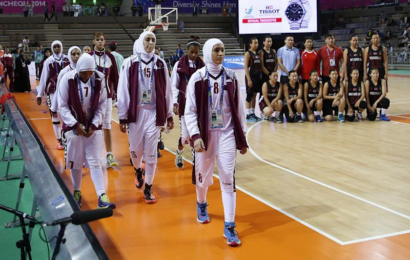 Basketball body says headwear ban not religious as Qatar quit