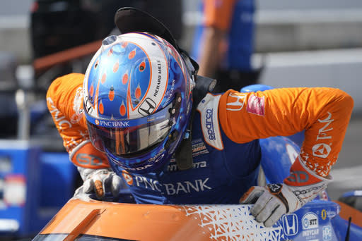 Scott Dixon, of New Zealand, climbs out of his car during qualifications for the Indianapolis 500 auto race at Indianapolis Motor Speedway, Saturday, Aug. 15, 2020, in Indianapolis. (AP Photo/Darron Cummings)