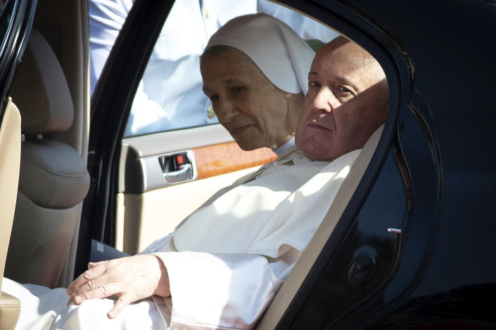 Pope Francis and his cousin Ana Rosa Sivori arrive for a welcome ceremony at the government house in Bangkok, Thailand, Thursday, Nov. 21, 2019. Pope Francis is on a four-day visit to Thailand. (AP Photo/Wason Wanichakorn)
