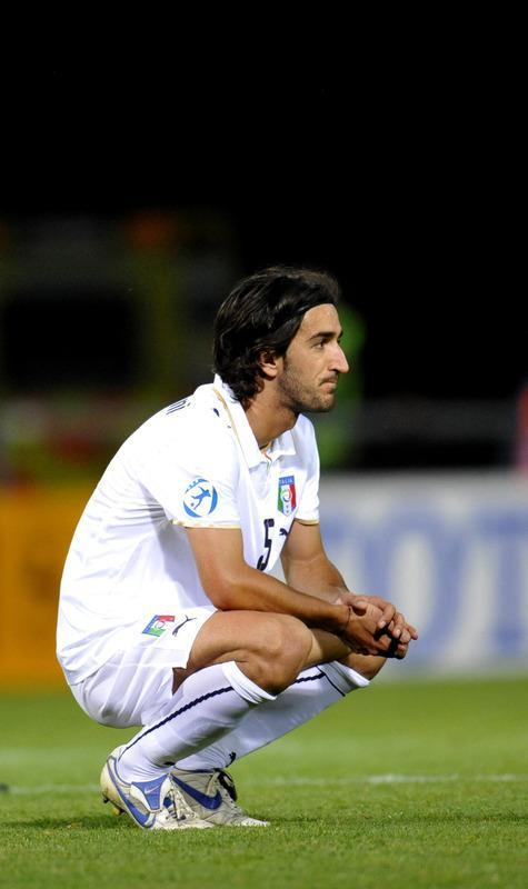 (FILES) A file picture taken on June 26, 2009 shows Italian player Piermario Morosini (C) reacting after losing the Euro U21 football championships semi-final match against Germany at the Olympia Arena in Helsingborg. Liovrno midfielder Piermario Morosini has died after suffering a suspected heart-attack during a match at Pescara on April 14, 2012, Italian media reported. The 31-year-old collapsed suddenly on the pitch during the game against Pescara leading to the match being abandoned. AFP PHOTO / SCANPIX SWEDEN / Pontus Lundahl ***SWEDEN OUT*** ALTERNATIVE CROP