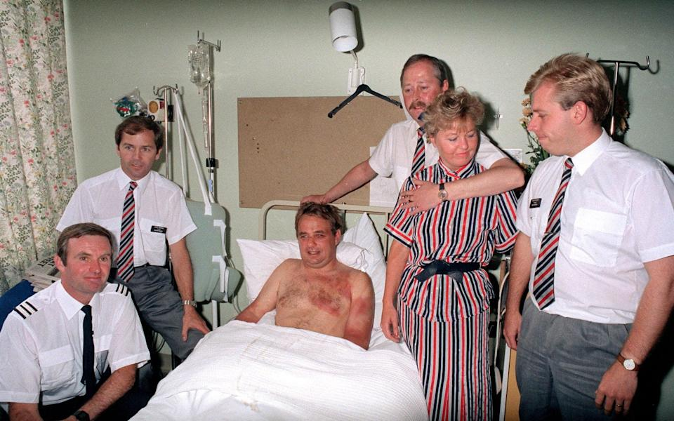 Captain Timothy Lancaster recovering in Southampton General Hospital. With him are crew members (l-r) Alistair Atchison, John Howard, Nigel Ogden, Susan Prince and Simon Roger - PA