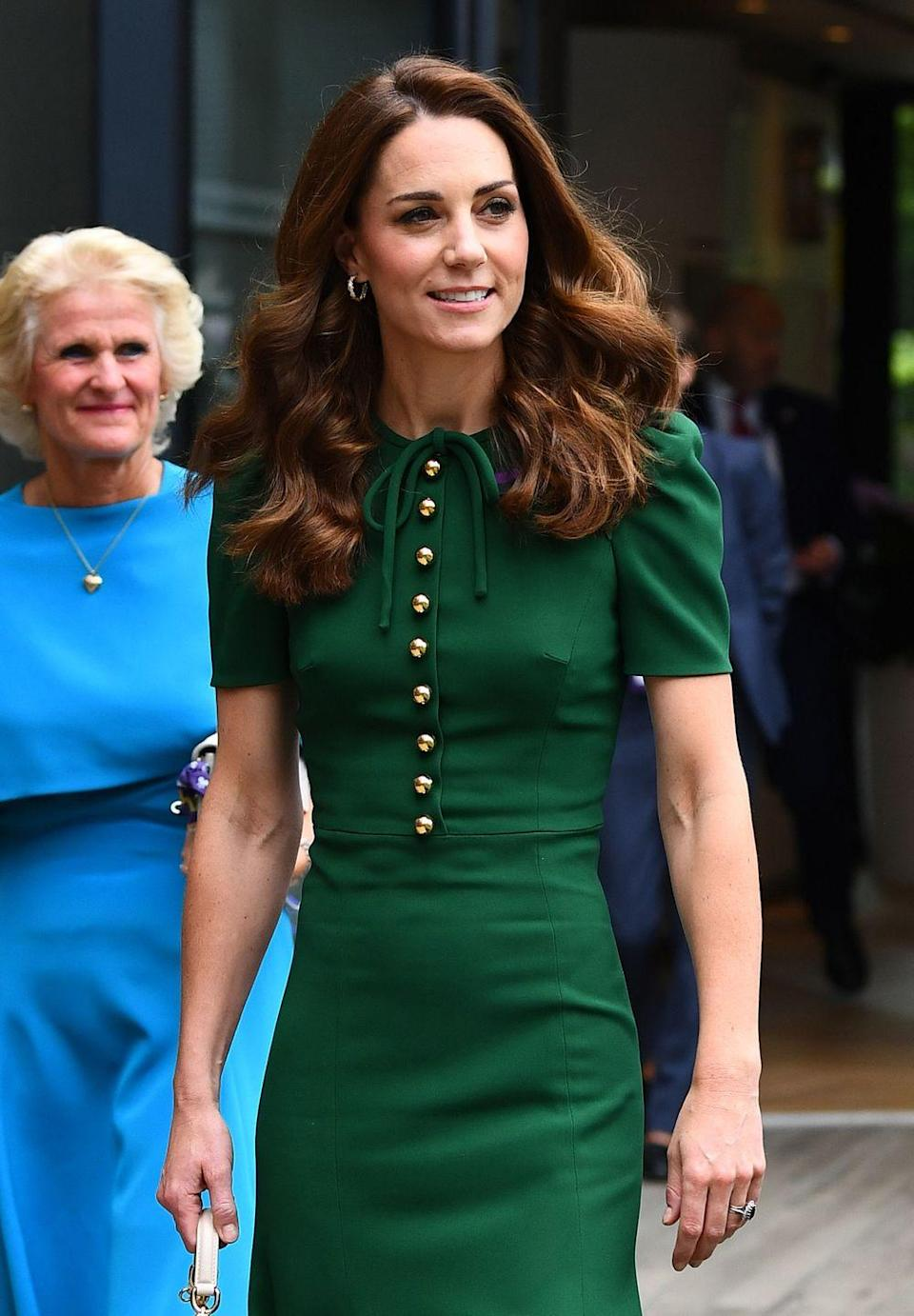 <p>The Duchess of Cambridge arrived at Wimbledon this morning wearing a rich green dress by Dolce and Gabbana, which she has worn before.</p>