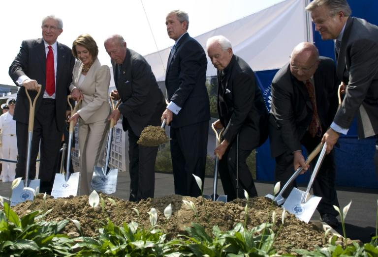 Top US diplomat and China scholar Richard Solomon, pictured (L) at a ground breaking ceremony with president George W. Bush (C)in  2008, has died aged 79