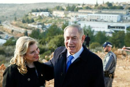 FILE PHOTO: Israeli Prime Minister Benjamin Netanyahu and his wife Sara pose for photographers after a memorial ceremony for late mayor of Ariel, Ron Nachman, in the Israeli settlement of Ariel in the occupied West Bank February 2, 2017. REUTERS/Baz Ratner/File Photo