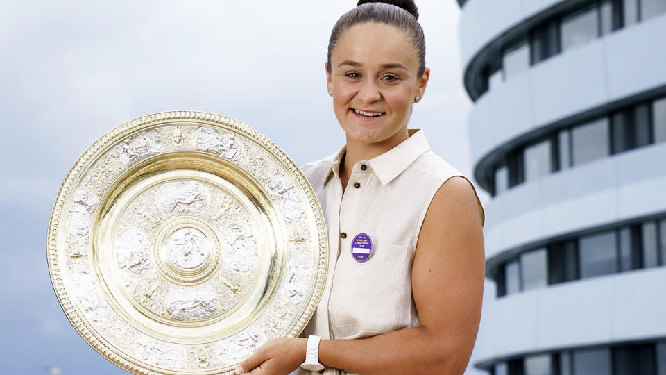Ash Barty, pictured here with the trophy after winning Wimbledon.