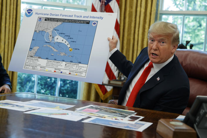 President Trump talks with reporters after receiving a briefing on Hurricane Dorian in the Oval Office of the White House in Washington, D.C., on Wednesday. (AP Photo/Evan Vucci)