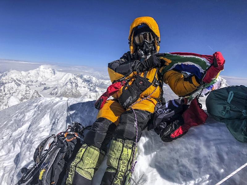 Saray Khumalo poses with a South African flag on May 16, 2019, after becoming the first black African woman to climb Mount Everest (AFP Photo/Handout)