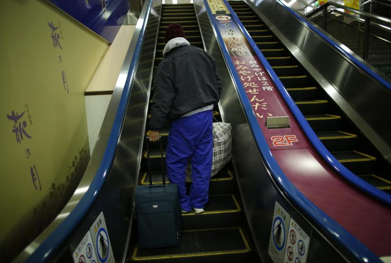 Shizuya Nishiyama, a 57-year-old homeless man from Hokkaido, takes an escalator at Sendai Station