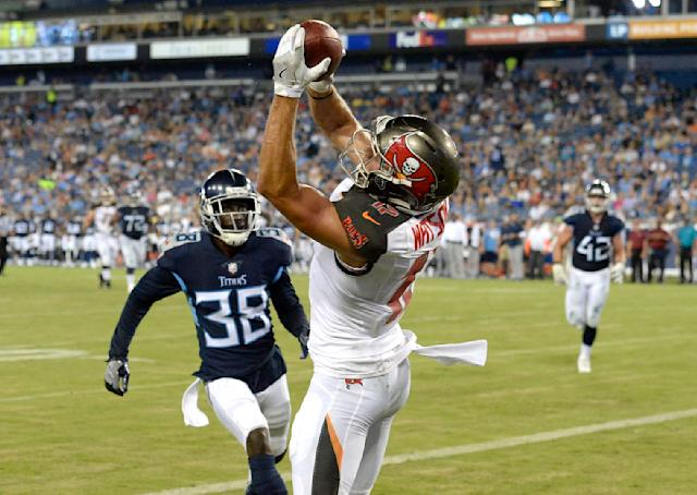 Tampa Bay Buccaneers wide receiver Justin Watson (17) catches a touchdown pass ahead of Tennessee Titans cornerback Kenneth Durden (38) in the first half of a preseason NFL football game Saturday, Aug. 18, 2018, in Nashville, Tenn. (AP Photo/Mark Zaleski)
