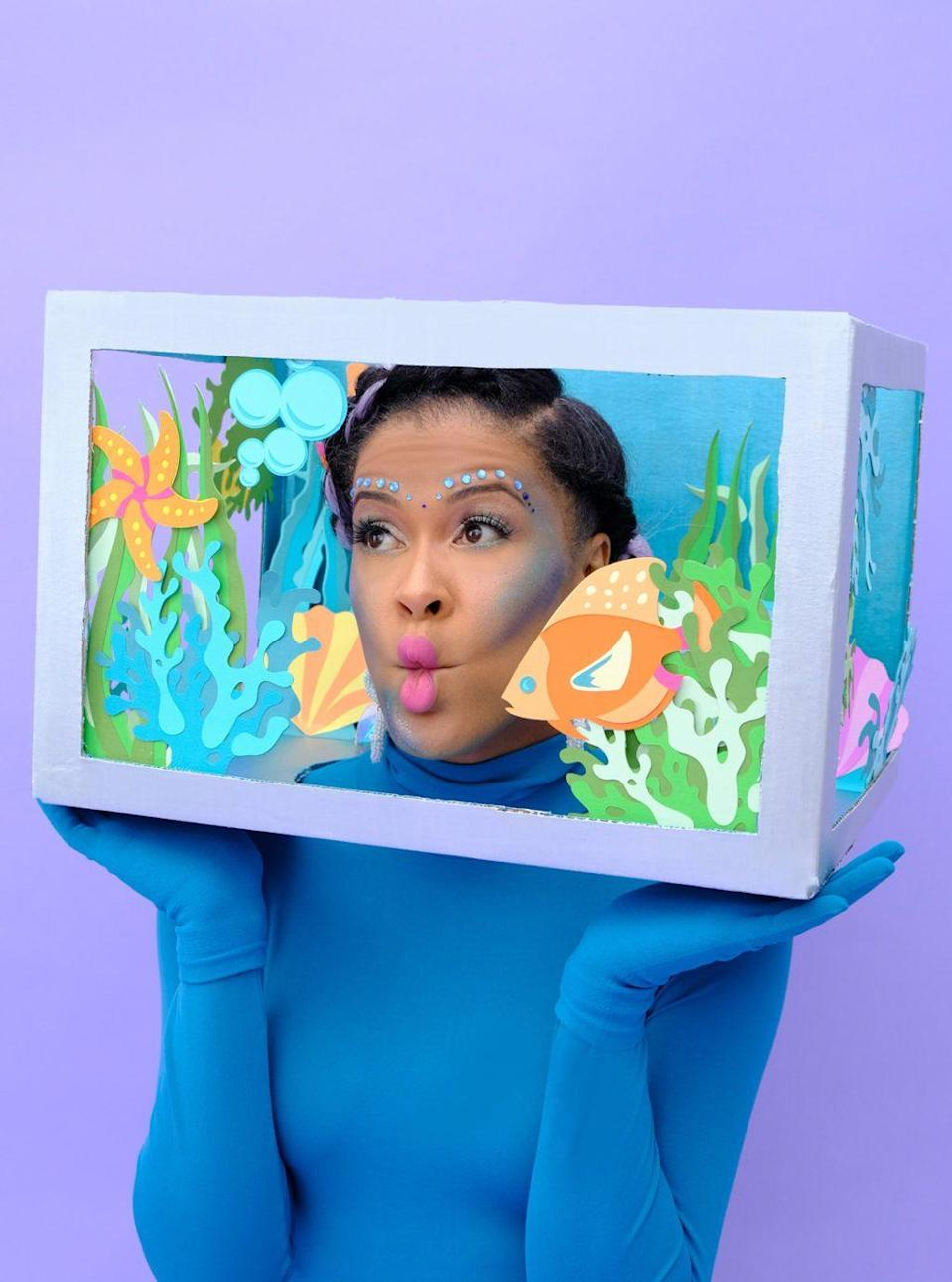 """<p>Amber Kemp-Gerstel shows you how to make an aquarium costume out of an old Amazon Prime box, something we all have in abundance!</p><p><strong>Get the tutorial at <a href=""""https://damasklove.com/how-to-make-an-aquarium-costume/"""" rel=""""nofollow noopener"""" target=""""_blank"""" data-ylk=""""slk:Damask Love"""" class=""""link rapid-noclick-resp"""">Damask Love</a>.</strong></p>"""