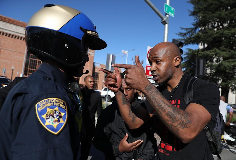 A California Highway Patrol officer is confronted by a Black Lives Matter protester during a demonstration Thursday in Sacramento, California.