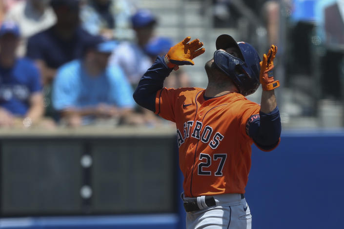 Houston Astros' Jose Altuve (27) celebrates his home run during the first inning of the team's baseball game against the Toronto Blue Jays in Buffalo, N.Y., Sunday, June 6, 2021. (AP Photo/Joshua Bessex)