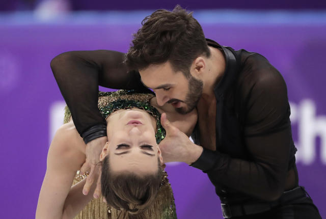 <p>Gabriella Papadakis and Guillaume Cizeron of France perform during the ice dance, short dance figure skating in the Gangneung Ice Arena at the 2018 Winter Olympics in Gangneung, South Korea, Monday, Feb. 19, 2018. (AP Photo/Julie Jacobson) </p>