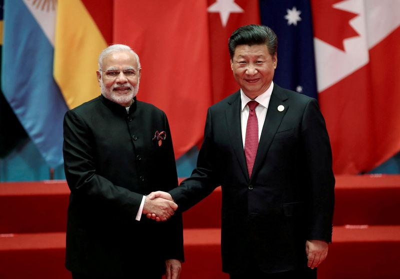 FILE PHOTO: Chinese President Xi Jinping shakes hands with Indian PM Modi during the G20 Summit in Hangzhou