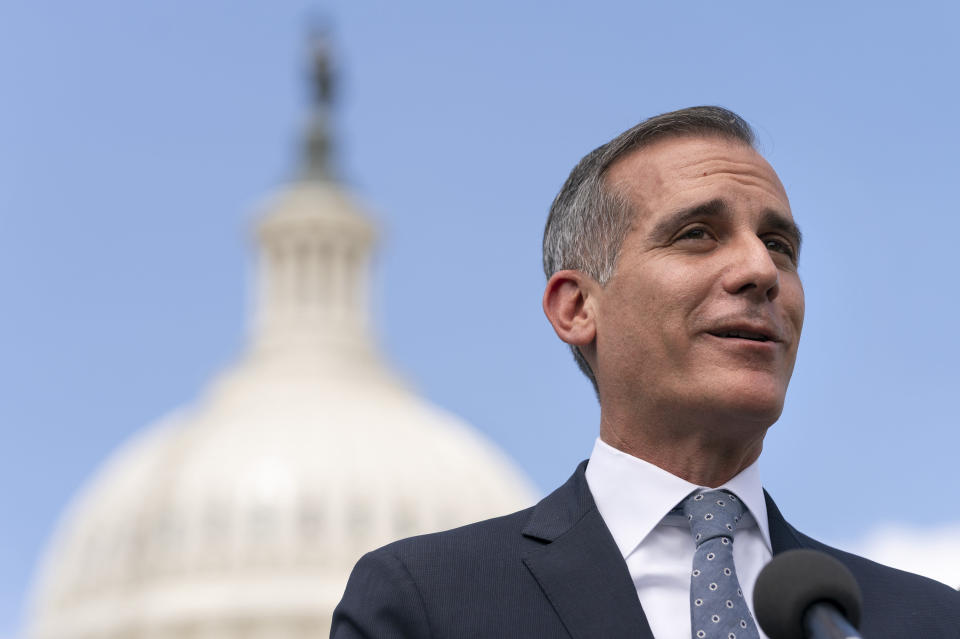 Los Angeles Mayor Eric Garcetti speaks during a news conference with House Transportation and Infrastructure Committee Chair Peter DeFazio, left, Wednesday, May 12, 2021, on Capitol Hill in Washington. (AP Photo/Jacquelyn Martin)