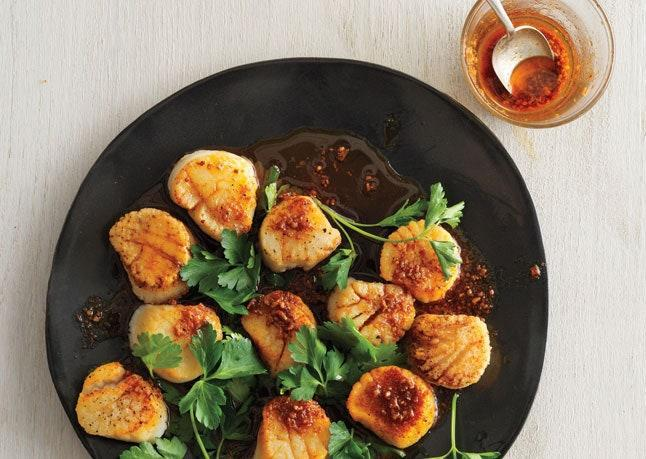 """Pro tip: Make the spice oil a week ahead to cut your prep time in half! <a href=""""https://www.bonappetit.com/recipe/scallops-with-spice-oil?mbid=synd_yahoo_rss"""" rel=""""nofollow noopener"""" target=""""_blank"""" data-ylk=""""slk:See recipe."""" class=""""link rapid-noclick-resp"""">See recipe.</a>"""