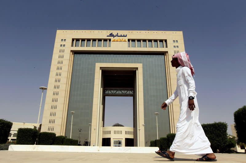 A man walks past the headquarters of Saudi Basic Industries Corp (SABIC) in Riyadh