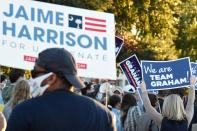 Supporters wave signs and chant outside the final debate between U.S. Sen. Lindsey Graham of South Carolina and Democratic challenger Jaime Harrison on Friday, Oct. 30, 2020, in Columbia, S.C. (AP Photo/Meg Kinnard)