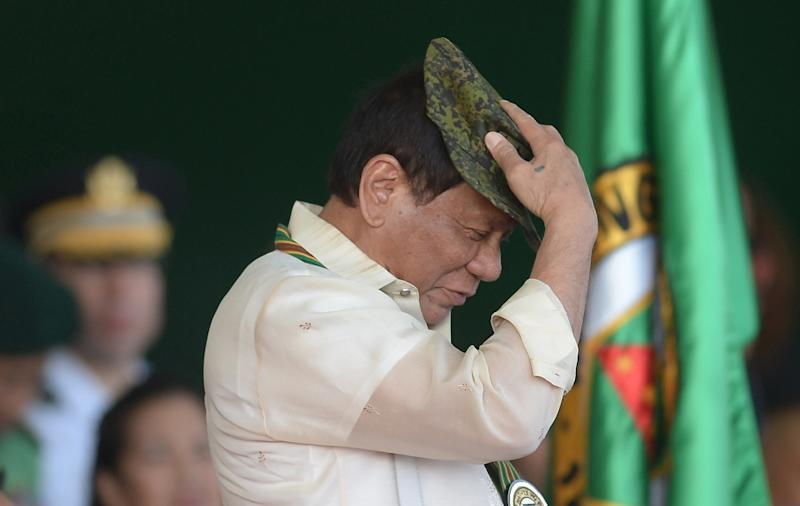 Philippine President Rodrigo Duterte has imposed martial law on the southern region of Mindanao to combat militants who have declared allegiance to the Islamic State group (AFP Photo/TED ALJIBE)