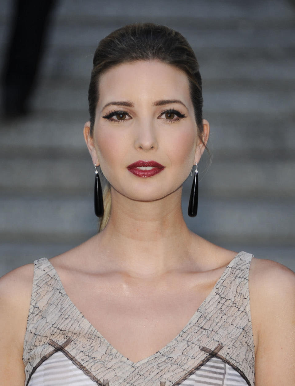 <p>In quite the contrast, Ivanka debuts a darker mane with a burgundy lip and cat eye. (Photo: AP Images) </p>