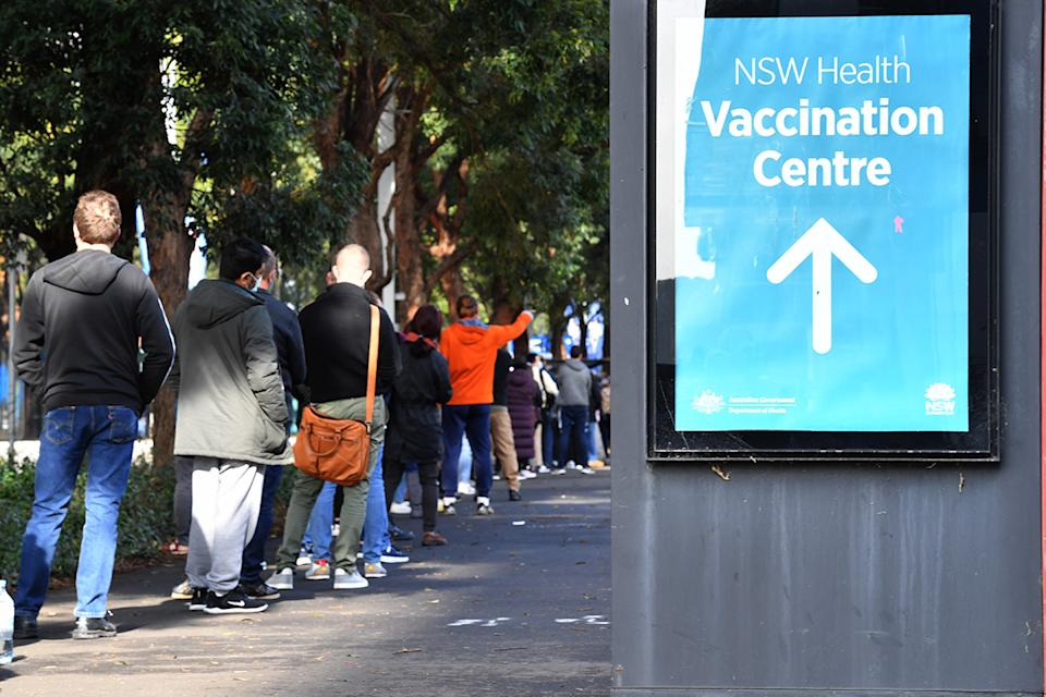People are seen queued to receive their vaccination at the NSW Vaccine Centre at Homebush Olympic Park on Thursday