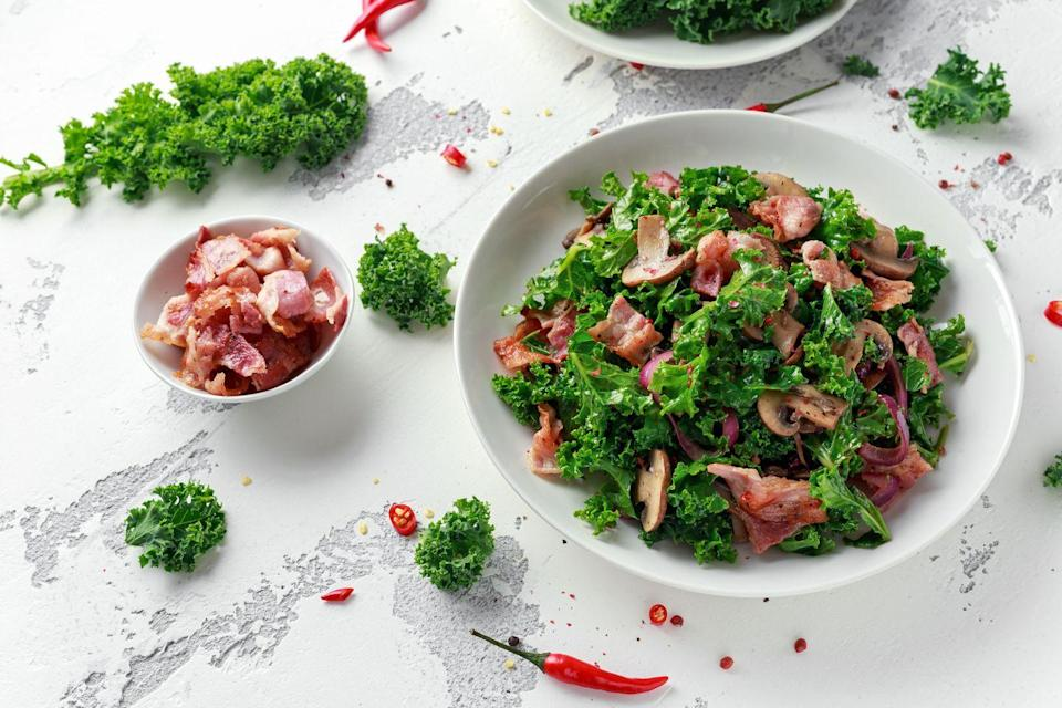 """<p>Hearty good-for-you greens get rich flavor from sautéed bacon and onion, plus a sprinkling of tangy goat cheese. Add <a href=""""https://www.goodhousekeeping.com/food-recipes/a29773655/keto-portobello-mushroom-pizza-recipe/"""" rel=""""nofollow noopener"""" target=""""_blank"""" data-ylk=""""slk:meaty mushrooms"""" class=""""link rapid-noclick-resp"""">meaty mushrooms</a> for extra oomph.</p><p><a href=""""https://www.goodhousekeeping.com/food-recipes/a10221/wilted-kale-salad-recipe-ghk0112/"""" rel=""""nofollow noopener"""" target=""""_blank"""" data-ylk=""""slk:Get the recipe for Wilted Kale Salad »"""" class=""""link rapid-noclick-resp""""><em><em>Get the recipe for Wilted Kale Salad <em><em>»</em></em></em></em></a></p>"""