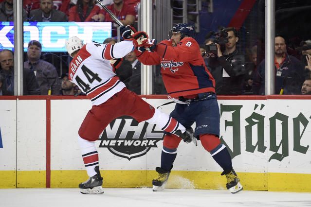 Washington Capitals left wing Alex Ovechkin (8), of Russia, shoves Carolina Hurricanes defenseman Calvin de Haan (44) during the second period of Game 7 of an NHL hockey first-round playoff series, Wednesday, April 24, 2019, in Washington. (AP Photo/Nick Wass)