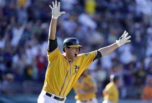 Oakland Athletics' Nate Freiman celebrates after hitting the game-winning RBI single off New York Yankees pitcher Mariano Rivera in the 18th inning of a baseball game Thursday, June 13, 2013 in Oakland, Calif. Oakland won 3-2 in 18 innings. (AP Photo/Eric Risberg)