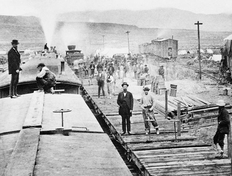 "FILE - In this April 28, 1869, file photo, workers laying tracks for Central Pacific Railroad pause for a moment at camp ""Victory,"" a few miles from Promontory, Utah. The May 10, 1869, completion of the Transcontinental Railroad was a pivotal moment in the United States, ushering in a period of progress and expansion nationwide. The presidents of the Union Pacific and Central Pacific railroads met in remote Promontory, Utah, to mark the occasion, driving a last ceremonial spike to connect their rail lines. (AP Photo, File)"