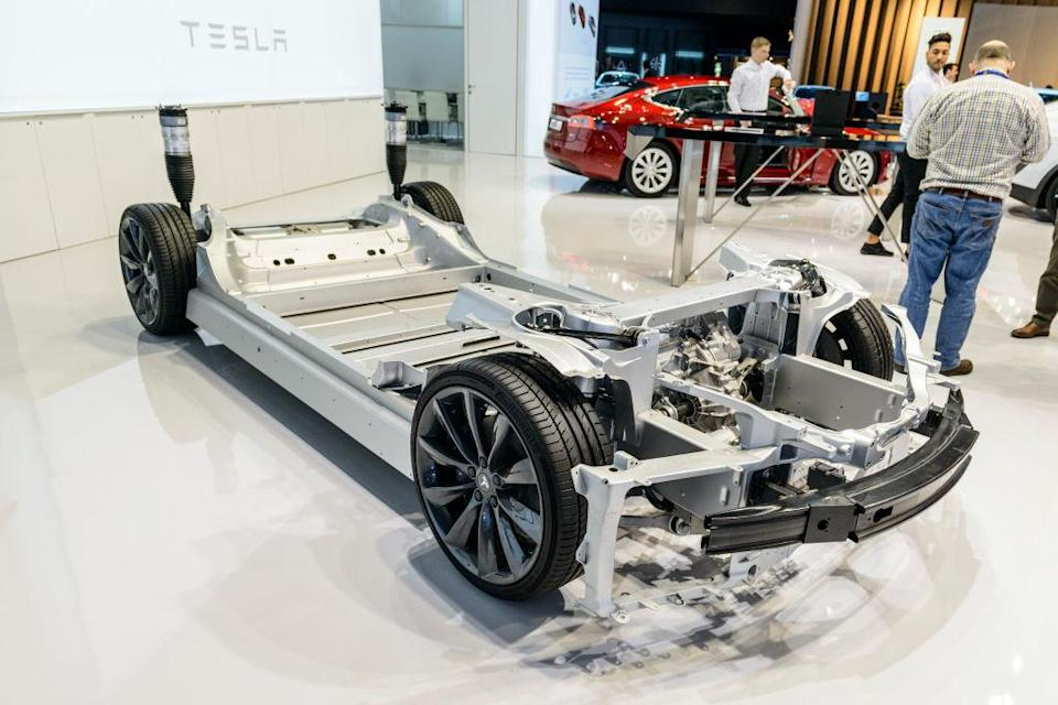 BRUSSELS, BELGIUM - JANUARY 13: Electric motor on a Tesla Model X full electric car chassis demonstration model on display at Brussels Expo on January 13, 2017 in Brussels, Belgium. The platform is fitted with the electric motors for the rear and front wheels and shows the empty space in the middle where the battery packs are fitted on the production models. (Photo by Sjoerd van der Wal/Getty Images)