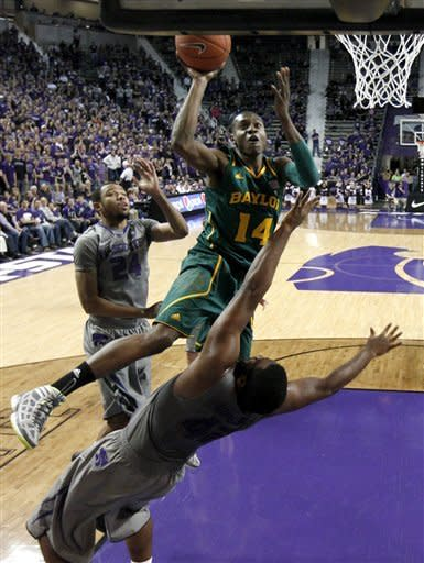 Baylor guard Deuce Bello (14) gets past Kansas State forward Thomas Gipson (42) to put up a shot during the first half of an NCAA college basketball game, Tuesday, Jan. 10, 2012, in Manhattan, Kan. (AP Photo/Charlie Riedel)