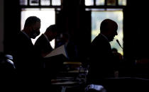 Rep. Chris Turner, D-Arlington, right, and Rep. Rafael Anchia, D-Dallas, left, line up to speak against HB 6, an election bill, in the House Chamber at the Texas Capitol in Austin, Texas, Thursday, May 6, 2021. (AP Photo/Eric Gay)