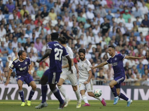 Real Madrid's Isco, second right, vies for the ball during the Spanish La Liga soccer match between Real Madrid and Valladolid at the Santiago Bernabeu stadium in Madrid, Spain, Saturday, Aug. 24, 2019. (AP Photo/Paul White)