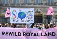 Environmental campaigners march ahead of the COP26 climate summit, in London