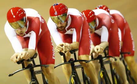 Bradley Wiggins rides second from the front with the England 4000m team pursuit during qualifying at the 2014 Commonwealth Games in the Chris Hoy velodrome in Glasgow, Scotland, July 24, 2014. REUTERS/Andrew Winning