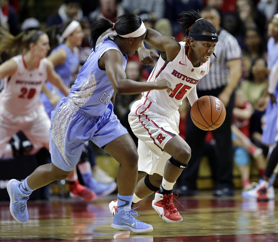 Rutgers' Syessence Davis (15) dribbles the ball past North Carolina's Jamie Cherry (0) during the first half of a women's NCAA college basketball game Thursday, Dec. 4, 2014, in Piscataway, N.J. (AP Photo/Mel Evans)