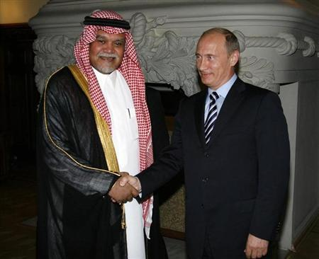 Prince Bandar bin Sultan, Secretary-General of Saudi Arabia's National Security Council shakes hands with Russia's Prime Minister Vladimir Putin as they meet in Moscow