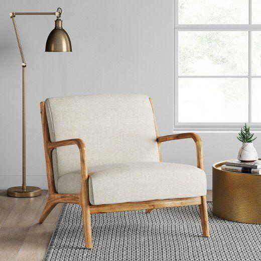 """<a href=""""https://www.target.com/p/esters-wood-arm-chair-husk-project-62-153/-/A-51785696#lnk=newtab"""" target=""""_blank"""">Shop it here</a>."""