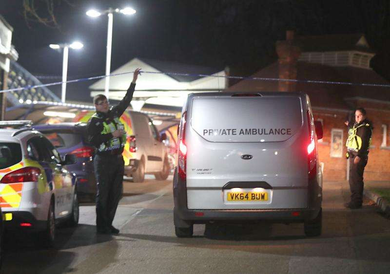 A private ambulance arrives at Horsley station near Guildford, Surrey, after a murder inquiry was launched following the stabbing of a man on board a train in Surrey.